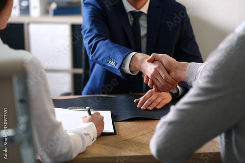 Canvastavla Male lawyer working with clients in office, closeup