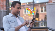 African Man Using Smartphone, Emoji, Comments And Likes