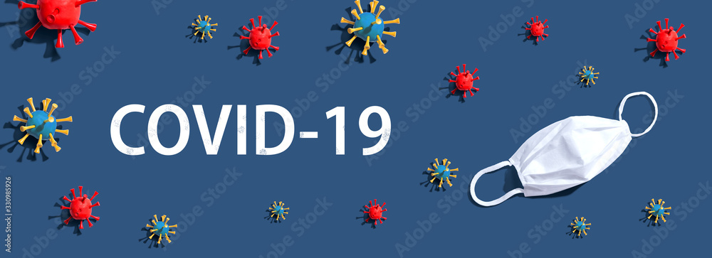 Fototapeta COVID-19 Coronavirus theme with virus and a white mask - flat lay