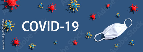 COVID-19 Coronavirus theme with virus and a white mask - flat lay - 330985926