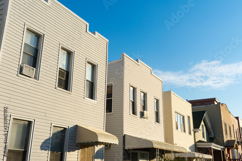 Photo A Row of Old Wood Homes in Astoria Queens of New York City
