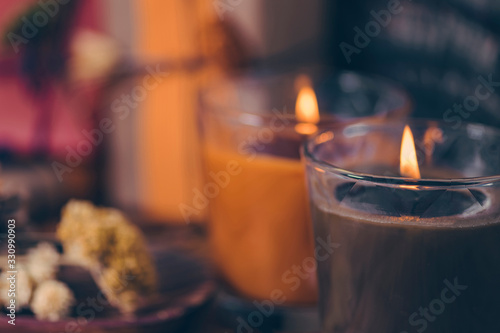 Fototapeta Scented Candles, Presents, Dried Flowers and Leaf Decoration on a Table