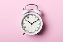 White Vintage Alarm Clock On P...