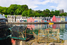 Lobster Traps And Colorful Hou...
