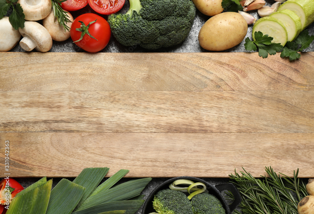 Fototapeta Fresh products and wooden board with space for text, flat lay. Healthy cooking