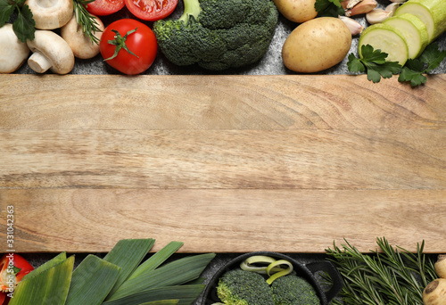 fototapeta na drzwi i meble Fresh products and wooden board with space for text, flat lay. Healthy cooking