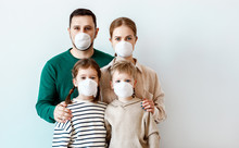 Family In Medical Masks During...
