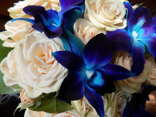 Wedding Bouquet Of Tea Spray Roses And Blue Orchids