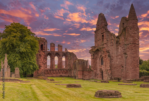 Photo Ancient Ruins of Arbroath Abbey at Sunset in Scotland
