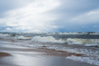 Dramatic sky and waves, a view from the seacoast. Stormy weather. Baltic sea, Latvia