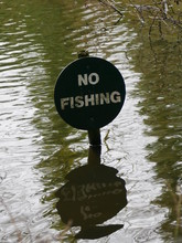Circular No Fishing Sign With ...