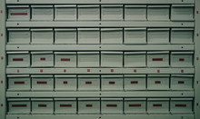 Metal Drawers Or Regals For Storing Different Parts. Fire Proof Containers At A Service Or Parts Warehouse. Side Angle View.