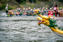 Dragon's Head With Dragon Boat Racing Team At The Back