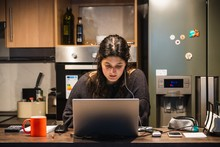 Young Spanish Girl Teleworking At Home Because Of The Restrictions Given By Spanish Government Due To Coronavirus COVID-19 Sanitary Crysis