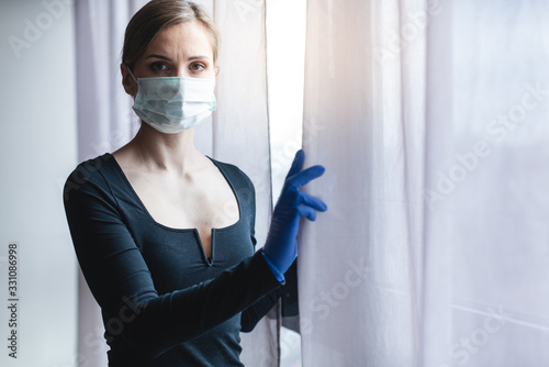 mata magnetyczna Bored woman in corona quarantine or under curfew