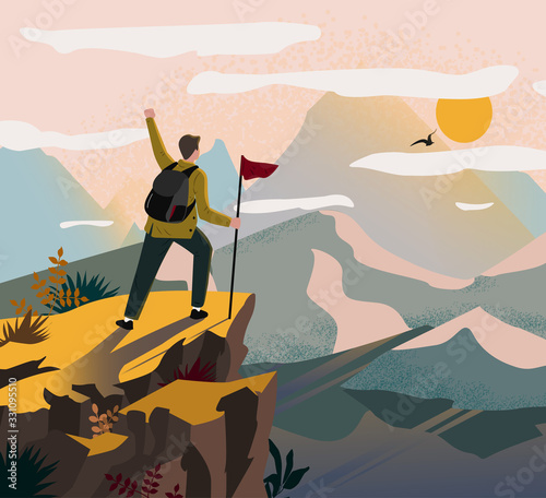 Fotografie, Obraz A traveler man on top of a mountain with a backpack and a flag triumphantly raised his hand and looking on valley