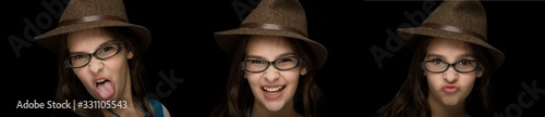 Fotografie, Obraz Twelve year old girl with fedora in a triptych on black background