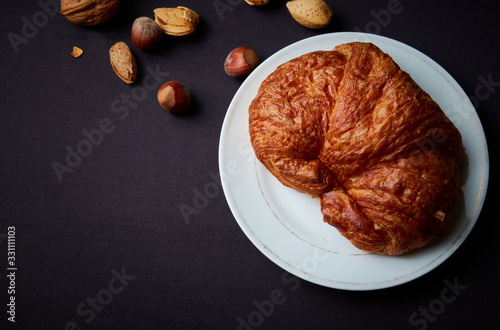 Crisp brown croissant on a table.