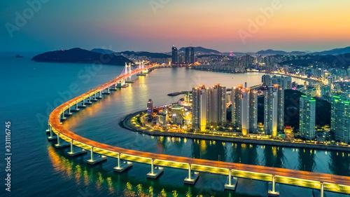 Obraz Aerial view Busan Gwangan Daegyo Bridge or Gwangan Bridge skyline and skyscraper building architecture illuminated in the night. Busan, South Korea.. - fototapety do salonu