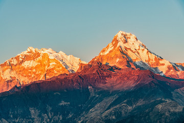 Panel Szklany 3D Majestic view of sunset sweeping through Annapurna South and Himchuli from Poon Hill, Ghorepani, Nepal