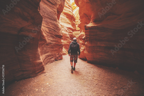 Fotografie, Obraz A man walking in canyon back to the camera