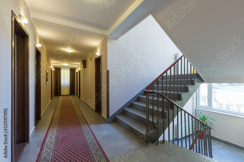 Interior of a hotel doorway with stairs Canvas-taulu