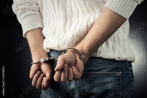 The man is arrested and handcuffed Canvas Print