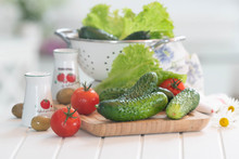 Summer Vegetables On White Table With Tomatoes, Salads, Olives And Cucumbers