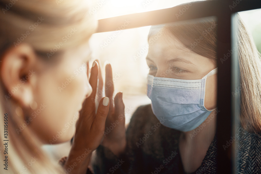 Fototapeta Mother and daughter are separated because of the quarantine Corona Virus Covid-19, social distancing