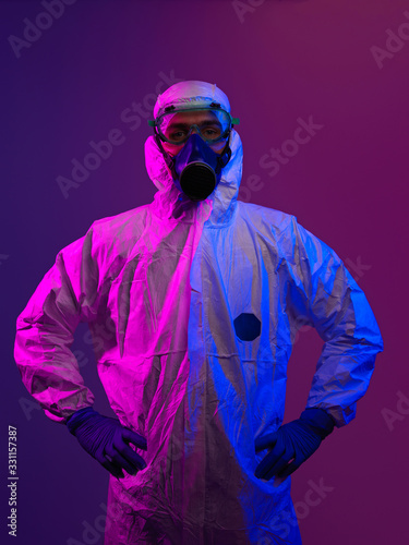 Doctor wearing protective biological suit and mask due to coronavirus - 331157387