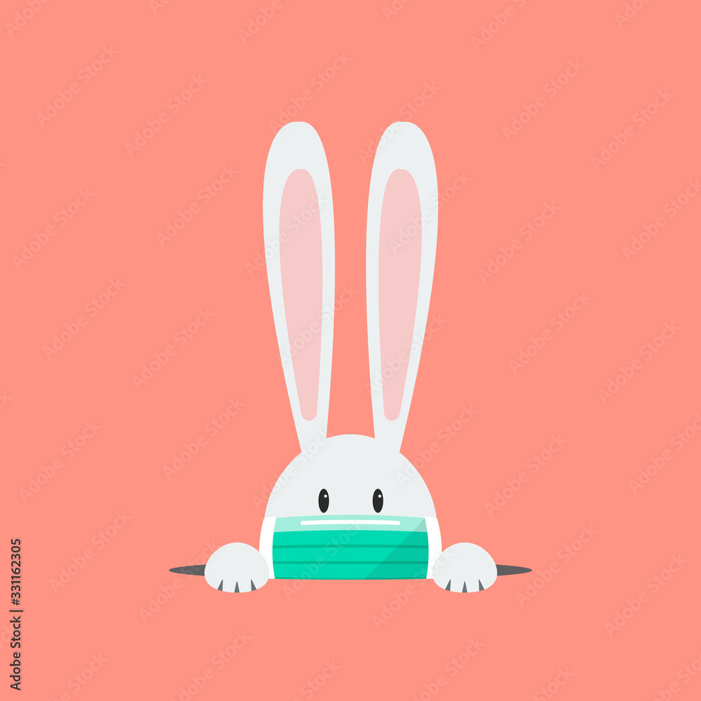 Fototapeta White rabbit wearing a protective mask