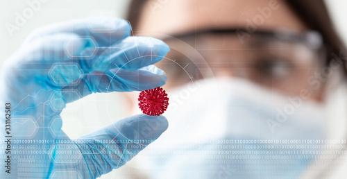 Stampa su Tela woman scientist holding a coronavirus in a research lab