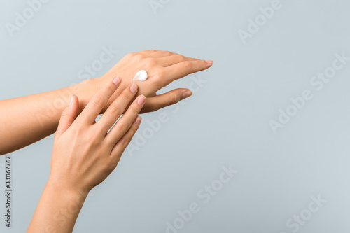closeup of tender hands of a young woman with moisturizer on Fototapete