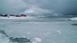 Sommarøy, Tromsø / Norway: Arctic Ocean frozen waters and colorful wooden houses in Sommarøya Island / Pan