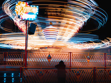 Funfair With Neon Lights And G...