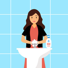 A Woman Washing Her Hands In T...