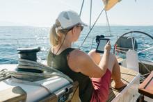 Woman Sitting On Deck Of A Yac...