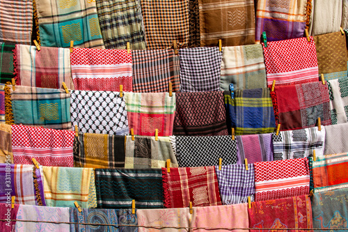 Colorful Bedouin scarfs for sale at one of the stalls in the historical city of Canvas Print