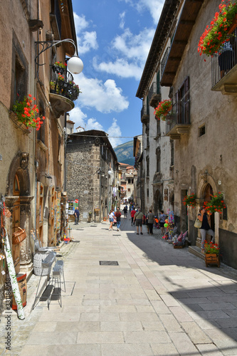 A narrow street between the old houses of a medieval village in Abruzzo © Giambattista