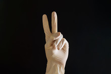 Hand In Latex Glove In V Sign ...