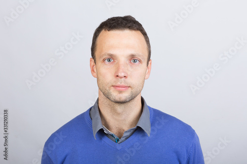 Fotografiet Young serious European man in smart casual clothing
