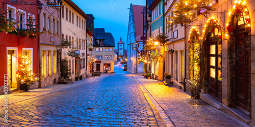 Panoramic view of Christmas street with gate and tower Plonlein in medieval Old Wallpaper Mural