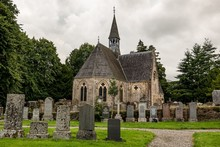 Very Old Luss Parish Church Dedicated To Saint Kessog With A Graveyard In Front Of It