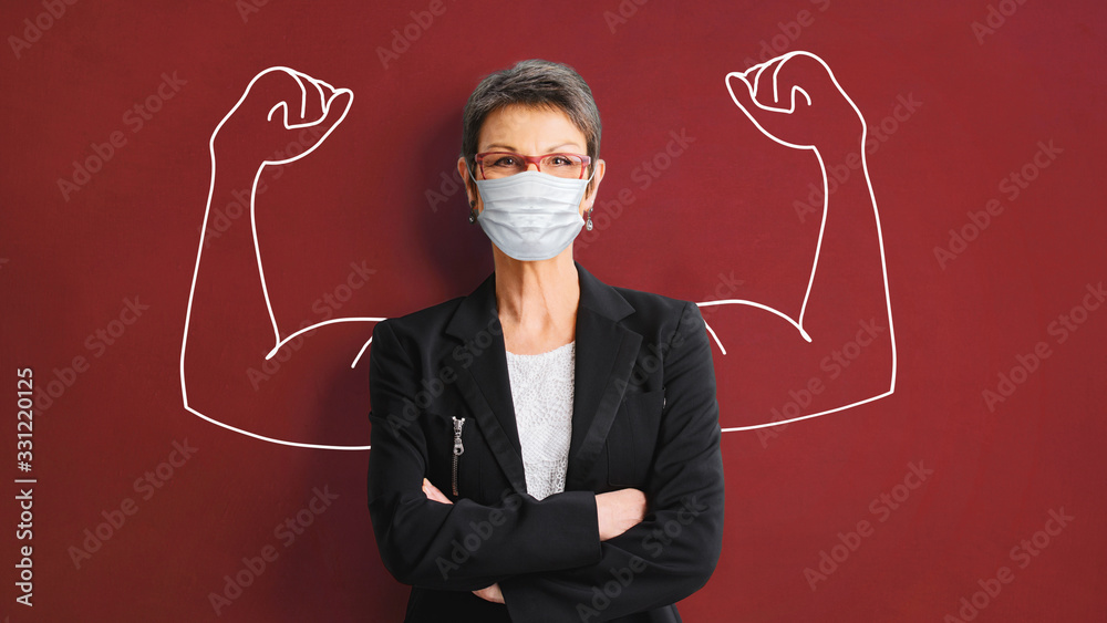Fototapeta Portrait of a successful, strong business woman in protective mask