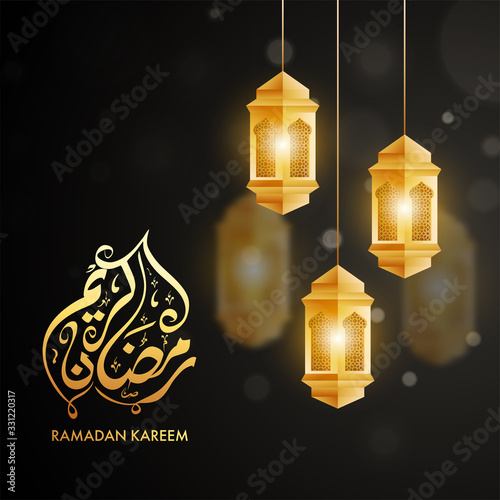 Golden Arabic Calligraphy of Ramadan Kareem Text with Hanging Illuminated Lanterns Decorated on Black Background Canvas Print