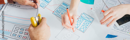 Cropped view of ux designers planning app frameworks near smartphone on table, p Fototapeta