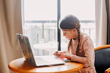 Schoolgirl Does Homework Lapto...