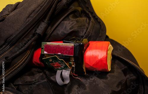 Papel de parede homemade bomb with a detonator in a black bag