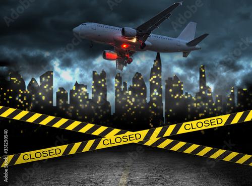 Obraz city closed under quarantine concept with plane - fototapety do salonu