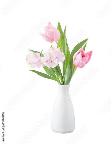 Obraz na plátně spring flowers in white vase isolated on white wooden background